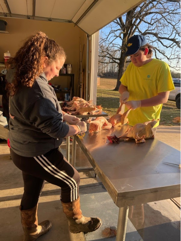 FFA members processing poultry