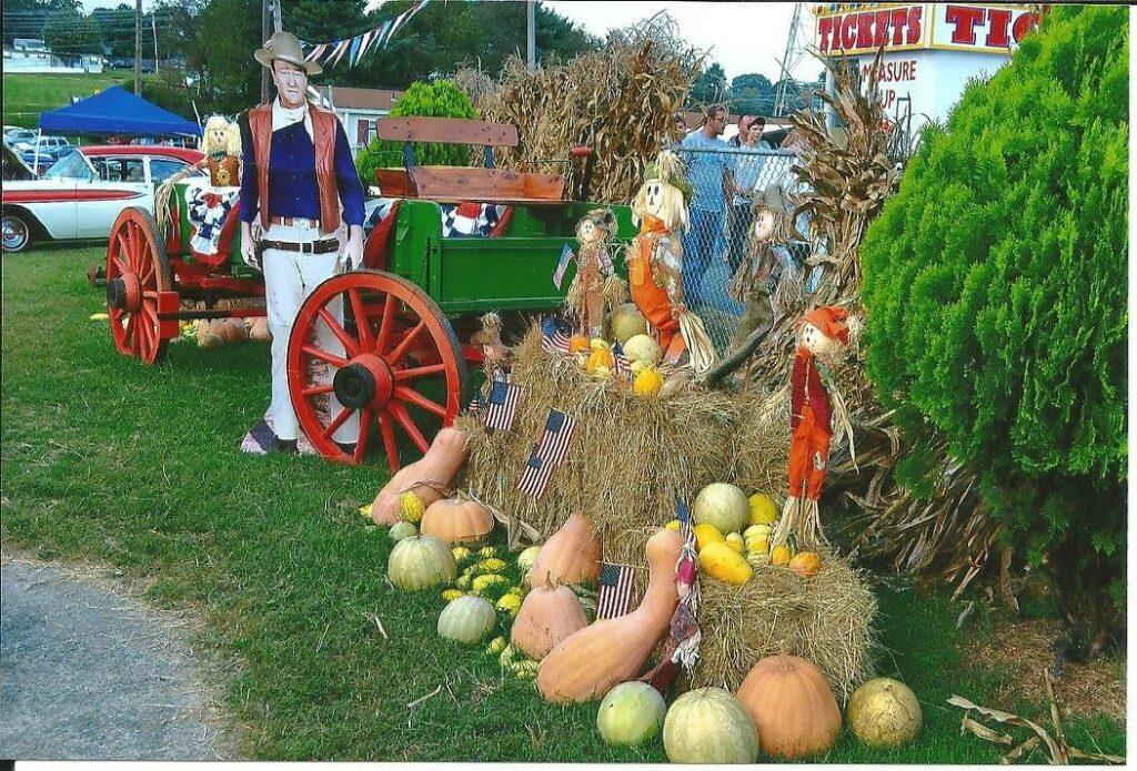 Pumpkins, gourds, and cart